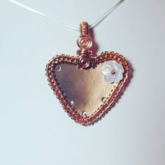 Check out this item in my Etsy shop https://www.etsy.com/uk/listing/505031339/bare-copper-wirework-heart-pendant-with