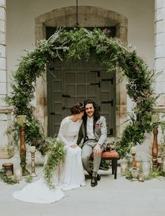 Greenery wreath backdrop - just like making a huge flower crown - see the Bride de Force DIY video. Looks amazing and can be made from greenery from your garden. Great photo back drop.