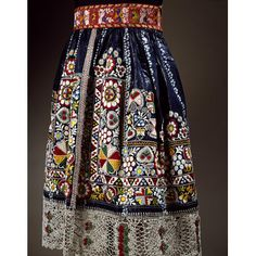 Czech republic, 19th century Apron made of glazed indigo-dyed cotton embroidered with multi-coloured cotton