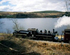 Image detail for -A steam train on the Brecon Mountain Railway, running past Pontsticill Reservoir in the Brecon Beacons National Park.