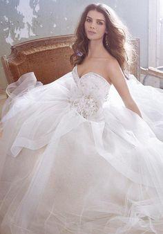 Strapless ball gown with cascading skirt | Jim Hjelm | https://www.theknot.com/fashion/8301-jim-hjelm-wedding-dress
