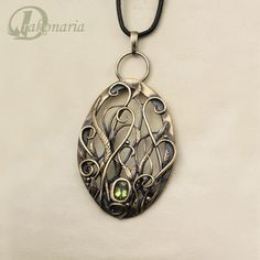 One of my favorite of her necklaces!  $152.00  http://www.etsy.com/listing/91795203/herbarium-gold-vines-olivine-pendant