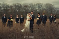 bridal party portraits, outdoor portraits, grassy field, fall wedding, bare trees, autumn wedding, black and white wedding, staggered bridal party pose, Steve DePino Photography, wedding portrait