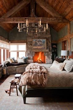 Stone fireplace becomes the focal point of the bedroom in Dancing Hearts