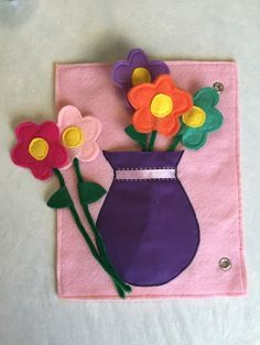 This flower vase quiet book page consists of a fabric vase that holds five different colored felt flowers. The flowers can be removed in and out of the vase. Besides needing a little help fitting them Diy Quiet Books, Baby Quiet Book, Felt Quiet Books, Vase Crafts, Felt Crafts, Diy And Crafts, Crafts For Kids, Felt Flowers, Fabric Flowers