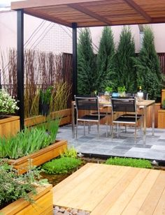 """Chicago Speciality Gardens, prizewinning rooftop garden. Entitled """"The Living Rooftop Movement"""", it was inspired by the creative use of the city's rooftops for environmental and recreational purposes. The natural materials and simple spacial levels made it modern and luxurious."""