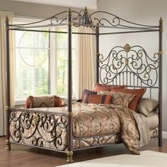 "Metal canopy bed with an ornate scrolling design. Product: Bed  Construction Material: Metal    Color: Brown and goldDimensions: 96"" H x 76"" W x 81.5"" D"