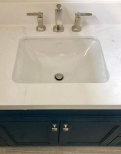 These square knobs with a bulbous shape to them from Top Knobs, work so well with the design of the Kohler Margaux faucet and the shape of the sink. Bath Cabinets, Wood Cabinets, Guest Bathrooms, Master Bathroom, Brass Cabinet Pulls, Kitchen And Bath Design, Building A New Home, Farmhouse Style Kitchen, Kitchen Styling