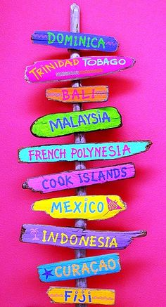 Various island direction signs in bright hot colors