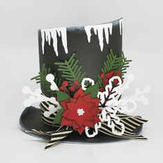 This paper Snowman Hat will bring a little magic to your holiday home. Isn't it adorable!!  I think it would make a great centerpiece for a table!!  Cute as can be!