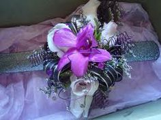 purple dendrobium orchids, white spray roses, black and silver accents and snap wristband
