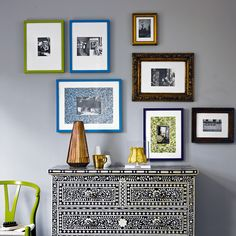 Yes I like this idea too. Painted frames to bring out the accent colours of a room.