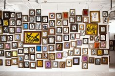 MULTIPLYING BUNNIES | Just inside the studio's entrance is this wall of rabbits, a series...