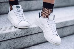 tomboy style, leather moto jacket, arm tattoos, girls with tattoos, adidas, stan smith, fishnet socks, casual dress http://randasalloum.com/how-to-wear-a-dress-casually/