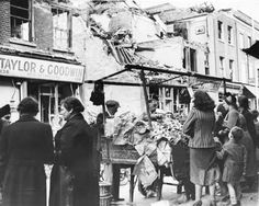 Lambeth was regularly struck by the Luftwaffe as can be seen in this photograph of Lambeth Walk in September Business-as-usual proceeds in the street, overlooked by a picture incongruously still hanging on the wall of the bombed-out building. Vintage London, Old London, London Bombings, Women In History, British History, British Home, The Blitz, Battle Of Britain, South London