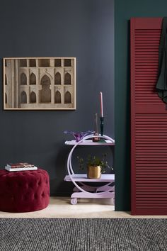 Opt for a small round console table for building your vignette. Here, the wall is painted Resene Nocturnal, the table and plant pot are in Resen. Interior Styling, Interior Design, Red Interiors, Table Arrangements, Red Paint, Four Seasons, Floating Nightstand, Interior Inspiration, Console Tables