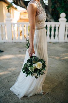 In love with this dress! http://www.stylemepretty.com/2014/10/21/glamorous-boca-raton-courtyard-wedding/ | Photography: Kallima - http://kallimaphotography.com/