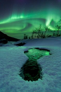 Aurora and reflections (by Arild Heitmann on 500px)