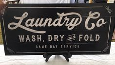Handmade vintage farmhouse style sign with a lovely saying, perfect as a gift for someone special or to add to your home decor. Laundry Co. wash, dry and fold same day service  24 x 12 wood Black sign distressed edges. Sawtooth hanger included.  • All artwork is handmade and distressed. Variations on each piece will occur.  • Want a CUSTOM phrase or size? Convo me for a personalized piece.  • Each piece made to order. Please expect a two week turnaround time before shipment. Shipping is with…