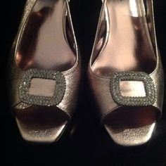 Silver 2 inch open toe dress shoe Worn once. Beautiful, comfortable shoe.   Purchased these sandals from Nordstrom.  Color was listed as Taupe.  They are an 11 D per my receipt.  Worn one time with champagne dress also in my closet.  Looked perfect! J. Renee Shoes