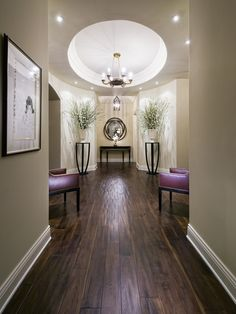 Contemporary Hall Design - I love the circular recess ceiling echoed by the round mirror on the end wall. I also love the symmetry of the space. Highly original and very chic......V