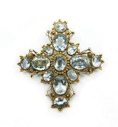 19th century aquamarine and gold cross brooch-pendant, c.1830   , the cruciform brooch set with oval cut stones, beadwork and filigree decorated frame, pendant hook to verso