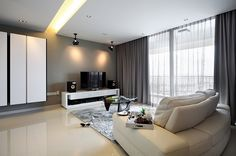 Contemporary living room in gray and white - Decoist