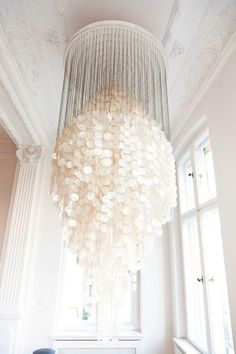 www.organicmatterscollections.com loves...  Capiz Shell Chandelier - #light-pinkish #white