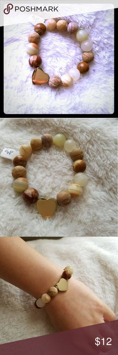 """Bracelet Beaded natural stone gold heart stretchy Beautiful,natural, great, quality gemstones beaded on thick elastic band.  Decorated with gold plated heart bead.  Size 6.5-7""""  This item features: * Natural Italian Onyx matte round shaped, *Gold plated heart bead  this is my original design all rights reserved the Queens Hand by Naya Jewelry Bracelets"""