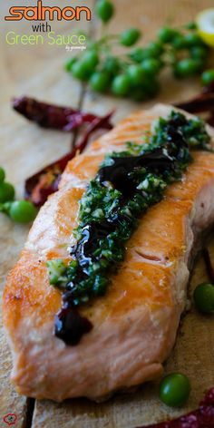 Pan-fried salmon topped with a tangy green sauce and pomegranate molasses. No better combination of flavors on a salmon than this! | giverecipe.com | #salmonrecipes #seafood #greensauce #friedsalmon #healthyrecipes #easyrecipes