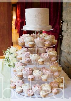 Vintage style wedding cupcake tower with top lace wedding cake. Pink and white.