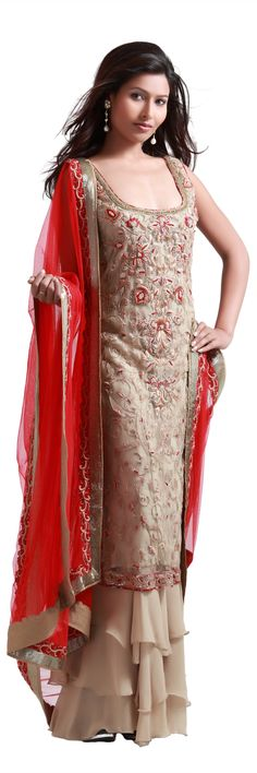 Gold net straight suit with resham work and long slits with a crepe sharara and a net dupatta.