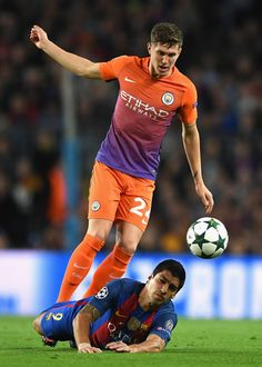 Luis Suarez of Barcelona goes down under the challenge of John Stones of Manchester City during the UEFA Champions League group C match between FC Barcelona and Manchester City FC at Camp Nou on October 2016 in Barcelona, Catalonia. Barcelona Futbol Club, Fc Barcelona, Barcelona Catalonia, Football Boys, Football Players, John Stones, Camp Nou, Professional Football, Uefa Champions League