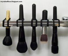 BRUSHES SHOULD BE DRIED UPSIDE DOWN - this is genius!  Just use hair-ties or rubber bands.