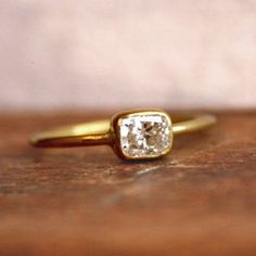 This was the inspiration for my custom-designed engagement ring. But my husband added a round diamond on each side, tiny diamonds on the band, and made it in rose gold.