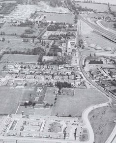 An aerial photograph from 1970, showing where the A13 goes through Pitsea.  What is the large building near the roundabout?  What is there n...