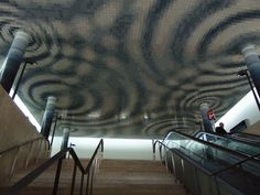 """Cota Zero"", New ticket hall, 2011, Catarina Almada Negreiros (1972) and Rita Almada Negreiros (1970), South and Southeast river station, Terreiro do Paço (Lisbon) (photo: Inês Leitão)   Inês Leitão. ""Rethinking frases in contemporary azulejo,"" in ARTisON - AzLab#14 Azulejos and Frames. Proceedings. 2 (2016), p. 100-108. URL: http://artison.letras.ulisboa.pt/index.php/ao/article/view/42"