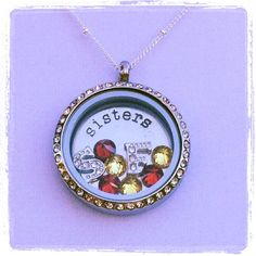 "Visit http://hayley.origamiowl.com/ to see the entire Origami Owl jewelry line and make your own Living Locket!     This is a Troubie-themed Living Locket: large silver locket with crystals, large silver ""Sisters"" plate, crystal ""S,"" crystal ""F,"" three red crystals, and three yellow crystals. This beautiful locket hangs from an adjustable 16""-18"" rolo chain."