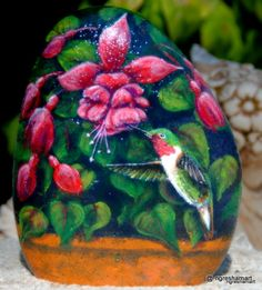 handpainted rocks,hummingbird paintings,yard art,home decor,rock art...This is so beautiful! I can see it in my flower bed!