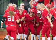 Husker players welcome Alicia Armstrong home after she hit a home run in the top of the fifth inning on May 19, 2013. NU beat the Stanford 10-5 in the NCAA regional finals at Bowlin Stadium in Lincoln. By: JAMES R. BURNETT/THE WORLD-HERALD