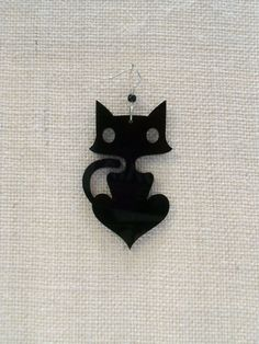 Big black cat acrylic earring - laser cut plexiglass - In Black Color. $8,00, via Etsy.