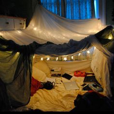 Ukulele, stack of books, and little star light = The perfect fort