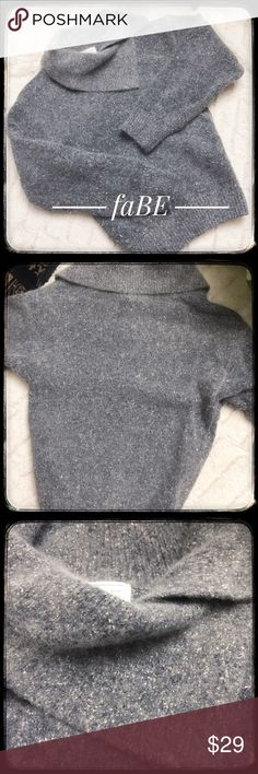 FaBE Silk Angora Blend Beautiful Sweater Stunning FaBE sweater with an amazing fabric blend. Silk and Angora Blend with the appeal of Angora and the strength of silk. The classic Gray is beautifully woven with small white and charcoal accents throughout. The neckline has a vintage appeal to it as well with a beautiful neckline. Soft and warm, this sweater is in good condition and ready to enjoy! FaBE Sweaters