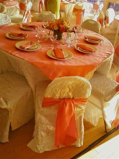 ivory crush satin chair covers with coral satin sash tie and overlay...San Diego CA