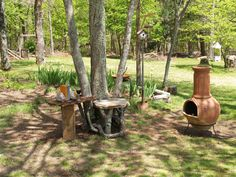 """As paul harvey said; """"page 2"""" the stick and stone seat and table with a little more thought and work turned into a cute little back yard space where you can read a book, have a glass of wine by a warm fire.  Listening to nature."""