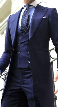 e7e032b44 Three piece suit flaunting the double-breasted vest