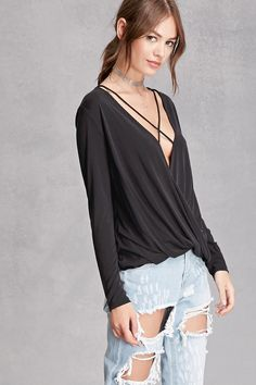 A knit top featuring a surplice front with crisscross straps, a high-low hem, and long sleeves. This is an independent brand and not a Forever 21 branded item.