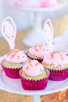 How pretty are these pink frosted ballerina cupcakes?! Love the ballerian toppers. See more party ideas and share yours at CatchMyParty.com #catchmyparty #partyideas #ballerinaparty #ballerinacupcakes #ballerinapartyfood