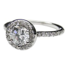 Vintage Style Round Diamond Halo Engagement Ring 0.56 tcw. Like Carrie Underwood-Fisher This is my favorite