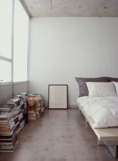 book stacks + concrete + white sheets